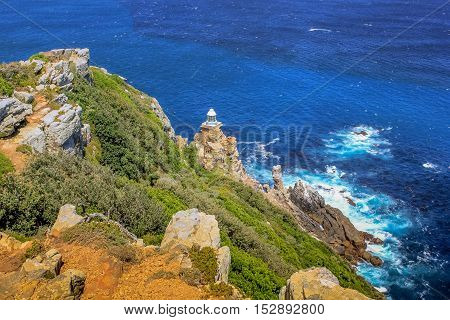 Panoramic view of the new lighthouse of Cape Point in Cape of Good Hope Nature Reserve in Cape Peninsula. Cape Point lighthouse is a popular landmark and icon in Western Cape, South Africa.
