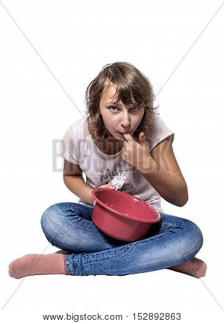 Girl teenager with red pot, licking finger