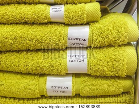 Towels mats robes and other home bath wear on shelves made of Egyptian Cotton