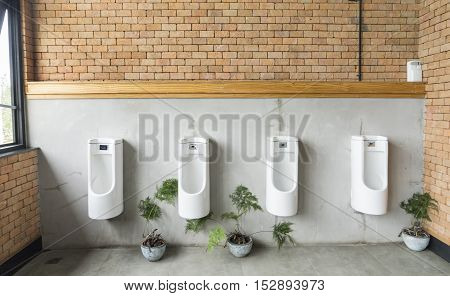 men toilet by brown brick wall - can use to display or montage on product