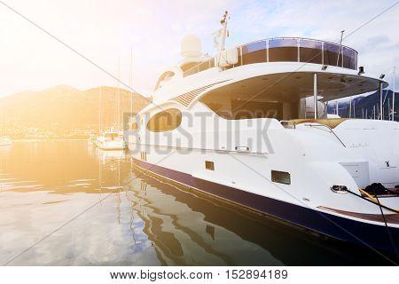 White Luxury Yacht In Marina