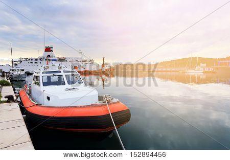 Red Emergency Boat In Dock