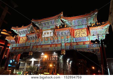WASHINGTON DC - OCT 10, 2011: The Friendship Archway spanning H Street in the heart of Chinatown at night, Washington DC, USA.