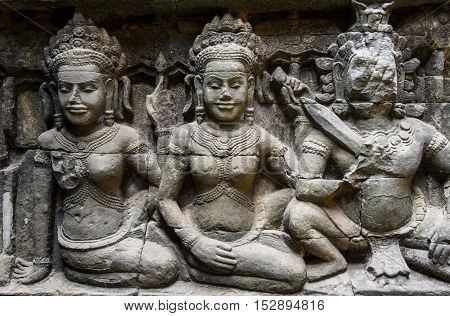 Apsara carvings status on the wall of Angkor temple world heritage