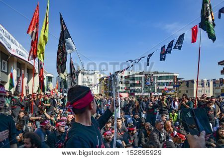 Istanbul Turkey - October 11 2016: Muslims worldwide marks Ashura Istanbul Shiite community. Turkish Shia Muslims mourning for Imam Hussain. Caferis take part in a mourning procession marking the day of Ashura in Istanbul's Kucukcekmece district Turkey