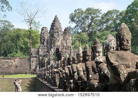 Deva or deity row at entrance of Angkor Thom, Siem Seap, Cambodia.