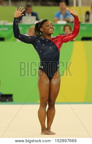Olympic champion Simone Biles of United States competes on the floor exercise during women's all-around gymnastics qualification at Rio 2016 Olympic Games
