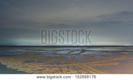 sandy beach in low tide in the night