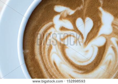 Closeup of  the art on the surface of Latte coffee.