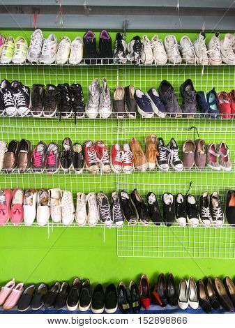 BANGKOKTHAILAND-Sep 21 : Rows of second hand shoes put on sale in the market fair Septembe 212016 in BangkokThailand.