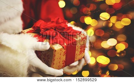 the Christmas gift in hand Santa Claus