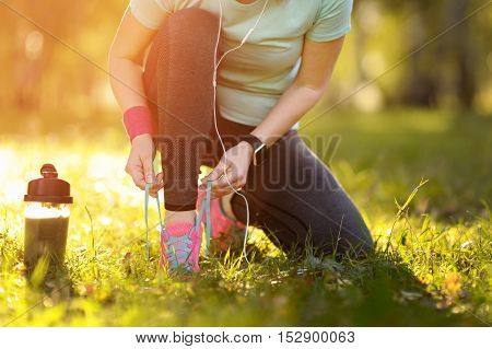 Sport Runner Woman Tying Laces Before Training. Marathon.