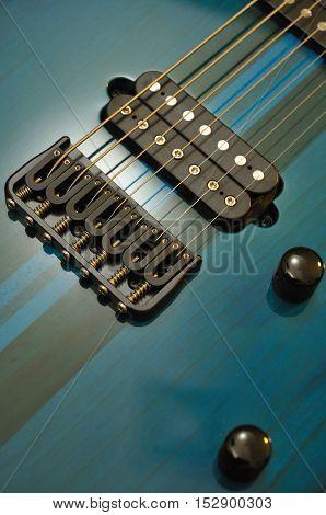 Closeup view of Teal color electric guitar strings