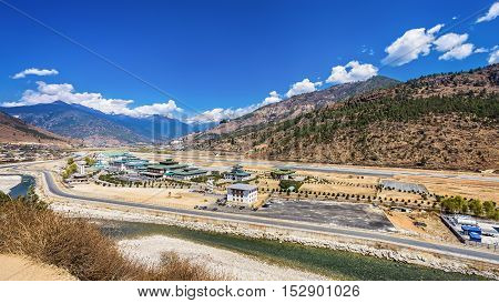 mountain landscape with village and mini airport