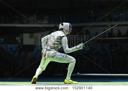 RIO DE JANEIRO, BRAZIL - AUGUST 12, 2016: Fencer Alexander Massialas of United States competes in the Men's team foil of the Rio 2016 Olympic Games at the Carioca Arena 3