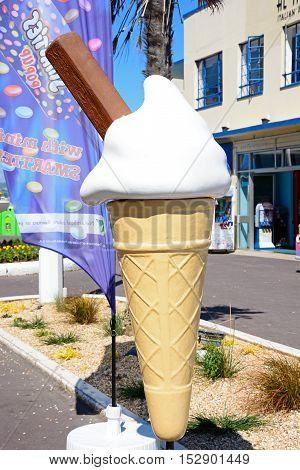 WEYMOUTH, UNITED KINGDOM - JULY 18, 2016 - Large ice cream cone outside the Pier Bandstand along the Esplanade Weymouth Dorset England UK Western Europe, July 18, 2016.