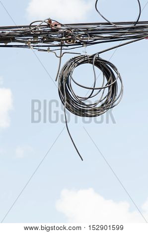Messy electrical cables.Dial wires tangled in Thailand.