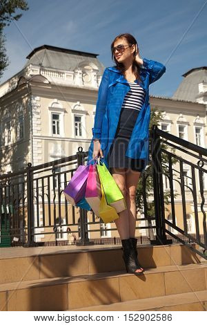 Young woman takes a walk after good shopping