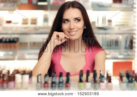 Happy Girl Choosing Between Bottles of Nail Polish