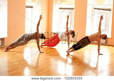 Group practicing yoga with real yoga  instructor