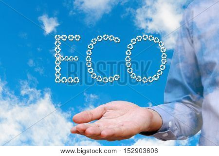 Man holding text eco and blue sky background with white clouds Environment concept