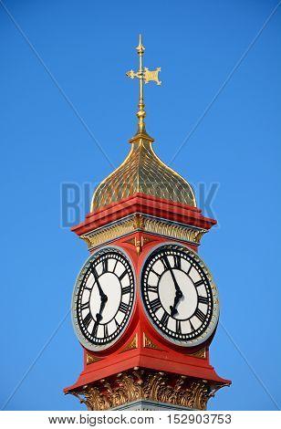 Top part of the Queen Victoria Jubilee clock tower along the Esplanade promenade Weymouth Dorset England UK Western Europe.