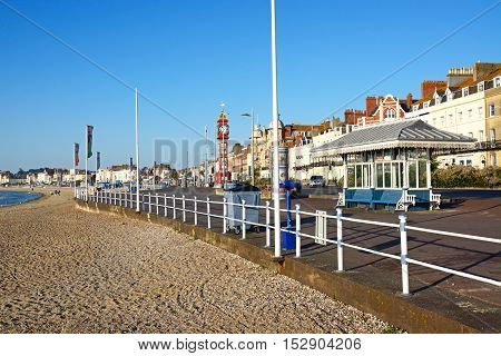 WEYMOUTH, UNITED KINGDOM - JULY 19, 2016 - View along the beach and Esplanade promenade with Queen Victorias Jubilee clock tower and guesthouses lining the road Weymouth Dorset England UK Western Europe, July 19, 2016.