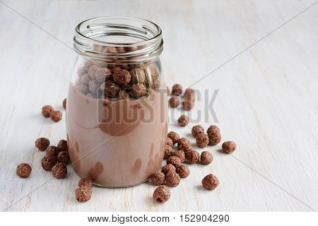 Chocolate Milk With Chocolate Cereal Balls In A Glass Jar