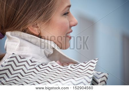 Woman is holding shopping bags. Selective focus