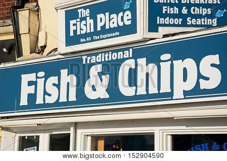 WEYMOUTH, UNITED KINGDOM - JULY 19, 2016 - Traditional fish and chips shop sign along the Esplanade Weymouth Dorset England UK Western Europe, July 19, 2016.