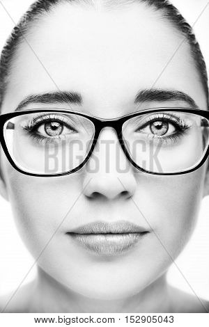 Attractive young optician woman In glasses. Monochrome