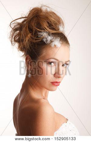 High fashion bride glances over her shoulder