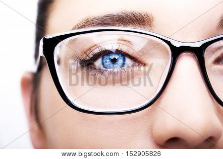 Beautiful young woman wearing glasses close-up. Isolated on white background.