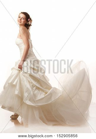 Bride in flying dress. Modern hairstyle with flowers