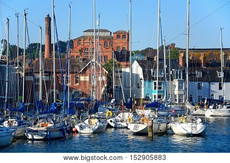 WEYMOUTH, UNITED KINGDOM - JULY 19, 2016 - Yachts in the harbour with Brewers Quay buildings to the rear Weymouth Dorset England UK Western Europe, July 19, 2016.