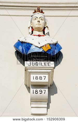 WEYMOUTH, UNITED KINGDOM - JULY 19, 2016 - Queen Victoria Jubilee Bust on the front of the Fairhaven Hotel along The Esplanade Weymouth Dorset England UK Western Europe, July 19, 2016.