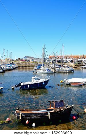 AXMOUTH, UNITED KINGDOM - JULY 18, 2016 - Fishing boats and yachts moored in the harbour Axmouth Devon England UK Western Europe, July 18, 2016.