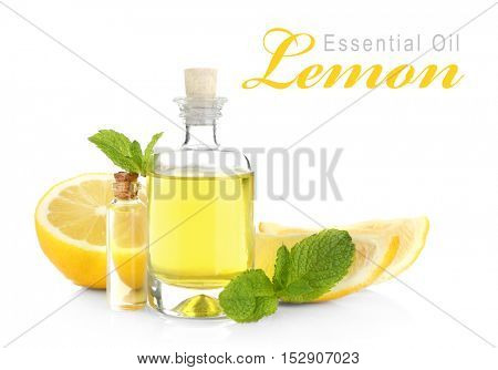 Spa composition with essence and lemon, closeup. Text LEMON ESSENTIAL OIL on white background. Spa beauty concept.