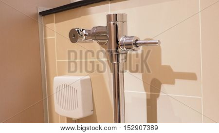 Toilet flush lever or controlling handle Stainless Steel and Carton disinfectants automatically in restroom.