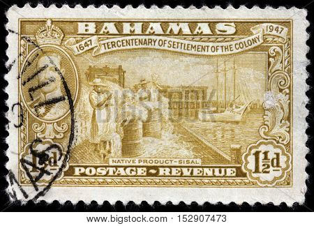 LUGA RUSSIA - JUNE 25 2016: A stamp printed by BAHAMAS shows native product sisal. The sisal fibre traditionally has many uses including rope twine paper cloth footwear and hats circa 1948