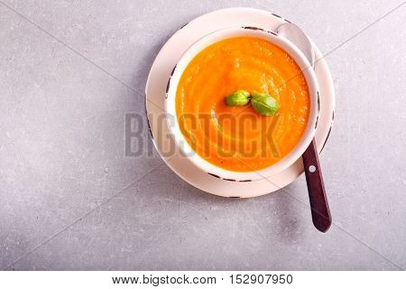 Carrot and ginger soup in a bowl top view