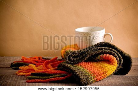 Scarf and cup of hot chocolate retro style