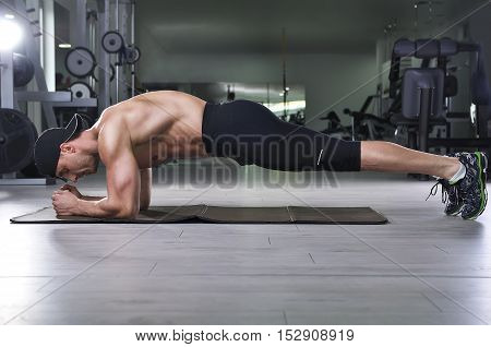 Handsome Powerful Athletic Man Doing Plank Exercise. Strong Bodybuilder With  Perfect Muscular Abs,