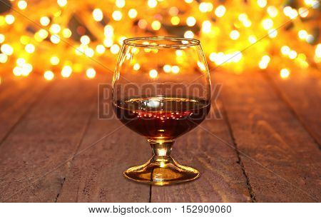 Photo Cognac Glass In Front Of Bokeh Background