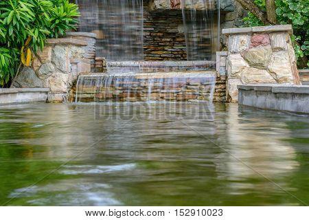 The landscape of beautiful waterfall in garden