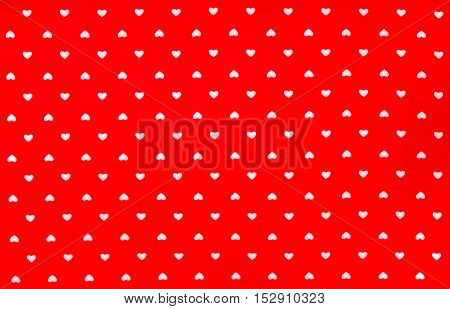 Red Fabric with white hearts pattern, texture, background, retro style Place your text or design.