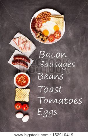 English breakfast prepared with two fried eggs, beans in tomato sauce, grilled tomatoes, mushrooms, bacon and toasts. Vertical orientation