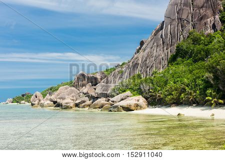 Beautifully shaped granite boulders and a perfect white sand at Anse Pierrot beach, La Digue island, Seychelles