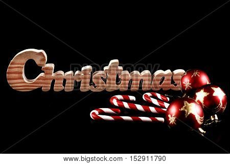 Christmas ball. Decoration candy and bauble isolated on black background
