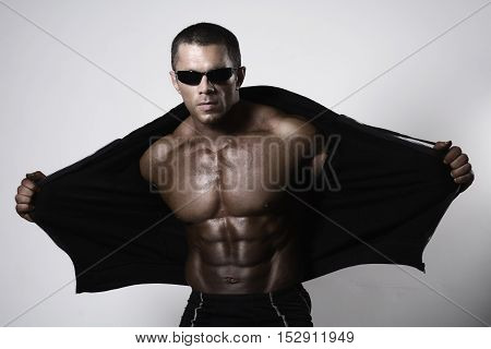 Muscular Young Man Opening His Jacket